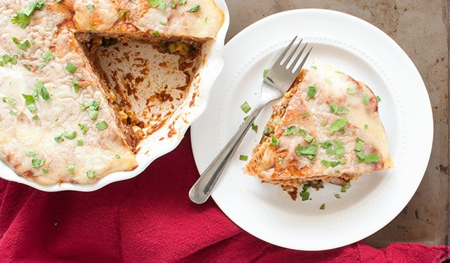 A vegetarian tortilla pie with beans, cheese, and the end of summer vegetables great to make ahead for a busy week. | Vegetarian Tortilla Pie from small-eats.com