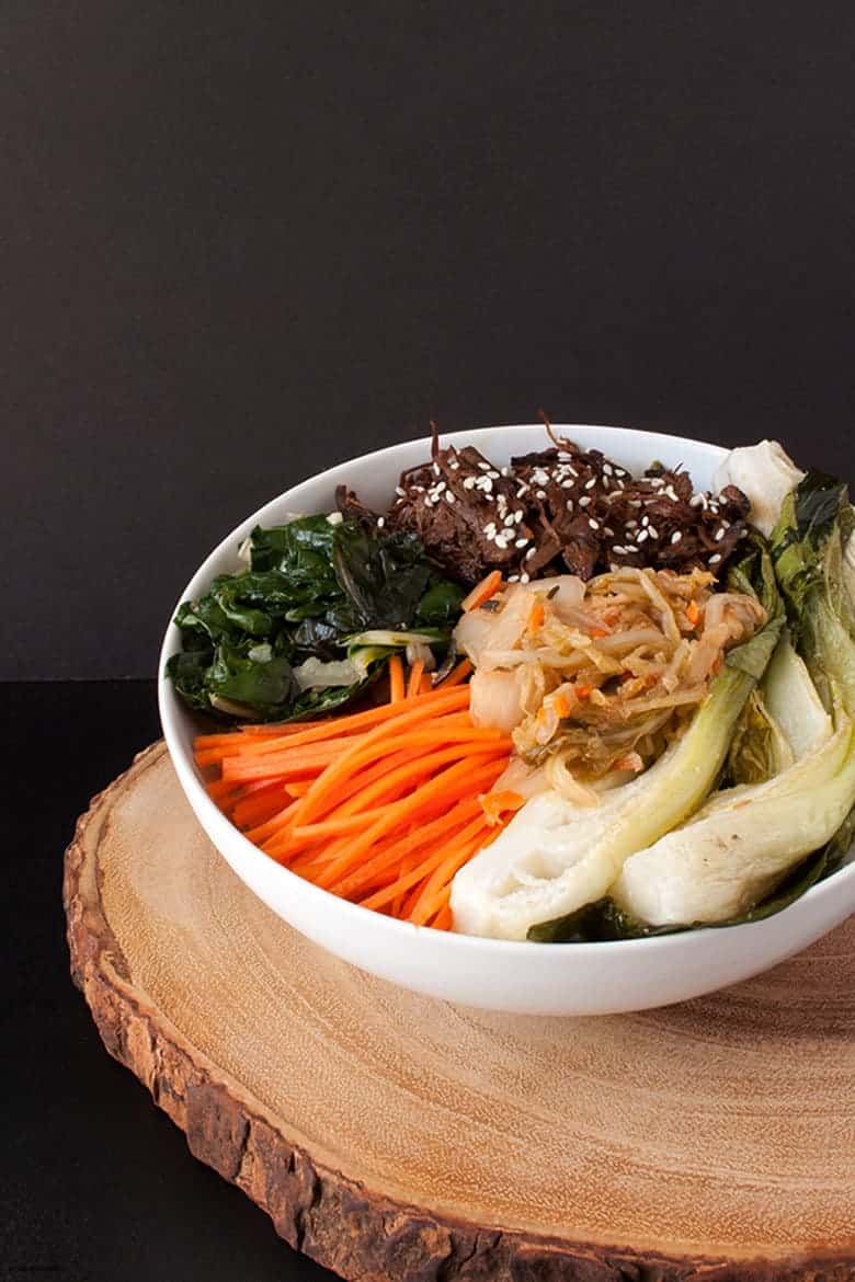 Enjoy a paleo twist to a Korean beef bowl, loaded with raw, cooked, and fermented veggies.  Korean Beef Bowls from small-eats.com