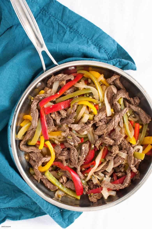 Enjoy a low carb and gluten free take on steak fajitas. | Keto Steak Fajitas from small-eats.com