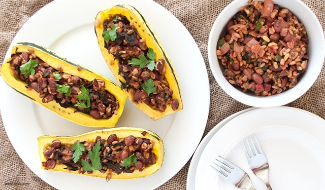 A stuffed delicata squash with Swiss chard, whole grains and red beans perfect for any fall meal.