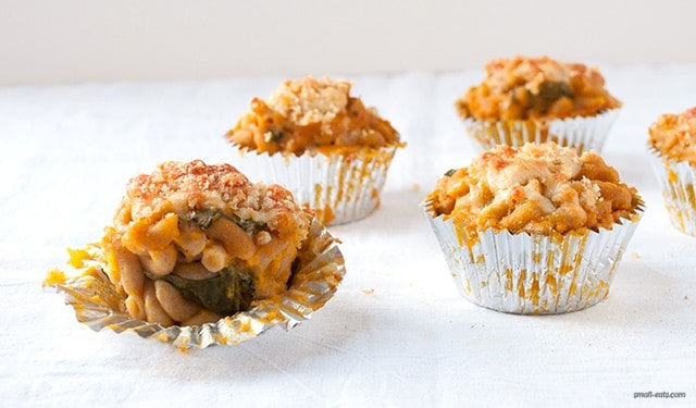 Make your mac and cheese party baked in a muffin tin and vegetable friendly with butternut squash and spinach.