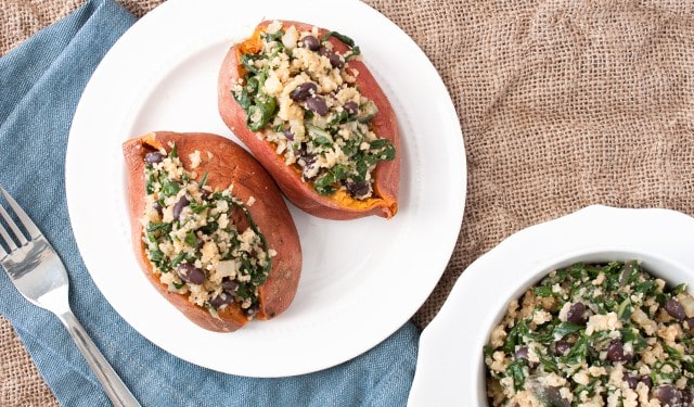 Up your stuffed sweet potato game with cauliflower rice, kale and black beans.