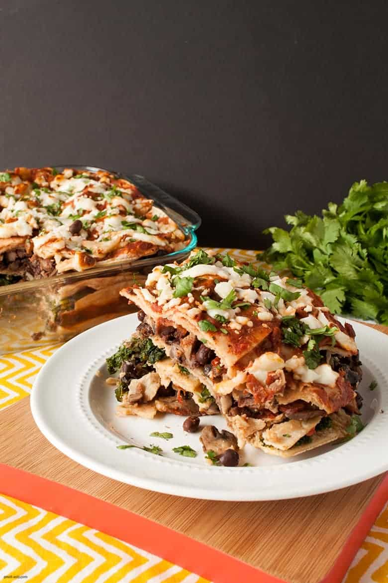 A filling, Mexican inspired casserole filled with black beans, kale, and mushrooms. | Greens and Beans Tortilla Casserole from small-eats.com