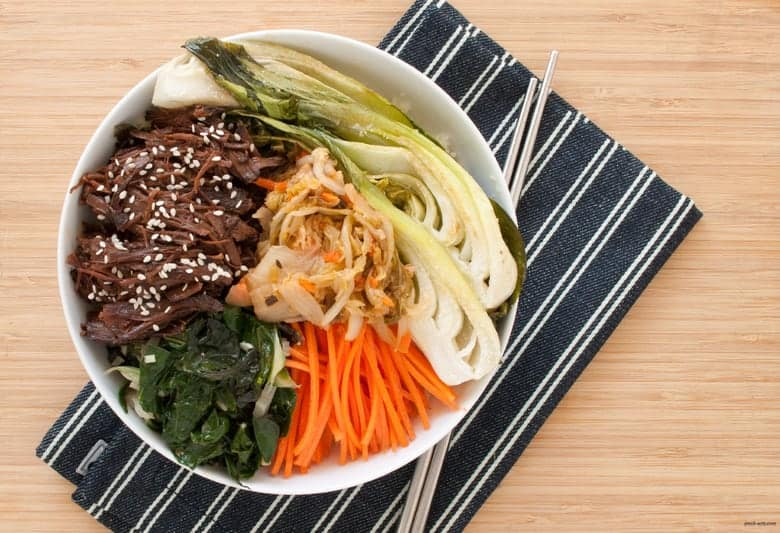 Enjoy a paleo twist to a Korean beef bowl, loaded with raw, cooked, and fermented veggies.| Korean Beef Bowls from small-eats.com