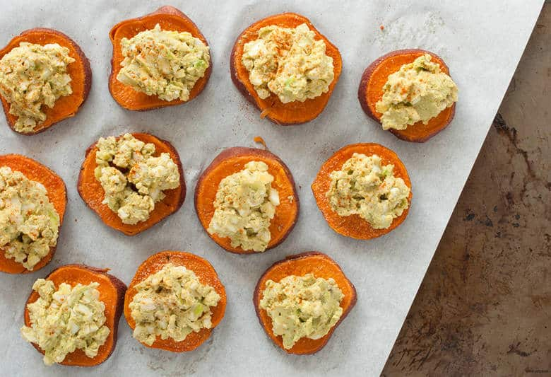 A paleo and avocado twist on egg salad on crackers perfect for snacking, entertaining, or a meal. | Huevocado Sweet Potato Toasts from small-eats.com