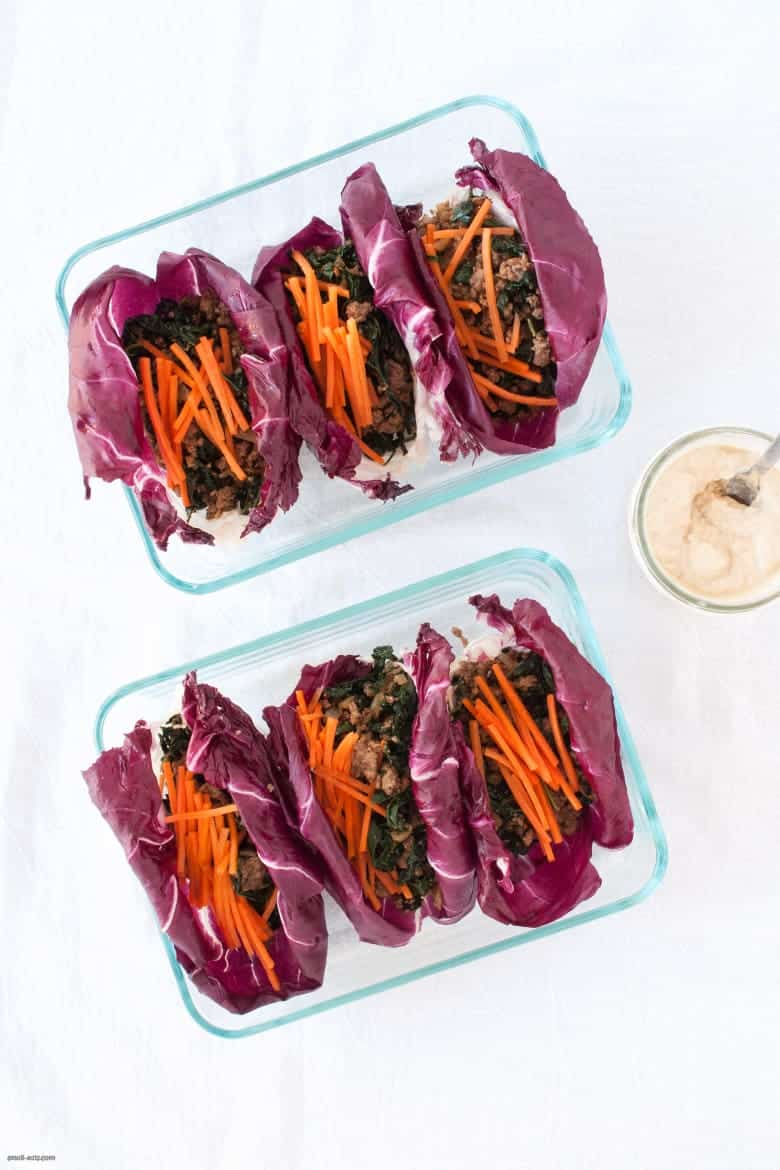 A portable, grain-free way to enjoy ground beef that's also packed with greens and carrots, topped with a tahini dressing. | Beef Radicchio Cups with Tahini Dressing from small-eats.com