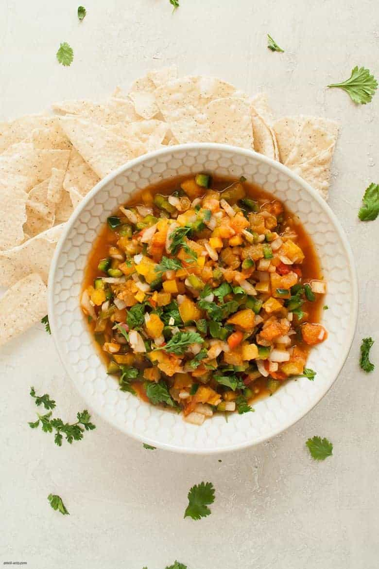 A bright, summery way to add a crunch to your meal and more veggies to your plate with a simple twist on a pico de gallo. | Bell Pepper Pico de Gallo from small-eats.com