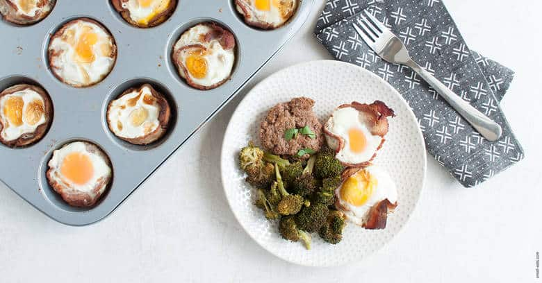A hearty savory breakfast with eggs, bacon and sausage that's portable, easy to make, and gluten, grain, and dairy free. | Bacon and Egg Muffins with Breakfast Sausage (Gluten Free, Dairy Free) from small-eats.com