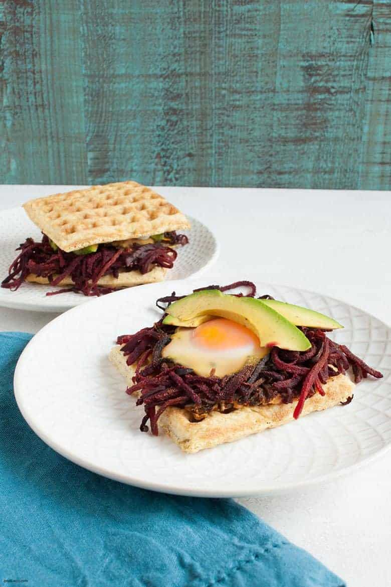 Start off your day with a fun, savory and gluten free breakfast that makes getting your veggies in easy. | Breakfast Egg Nest Sandwiches (Gluten Free) from small-eats.com