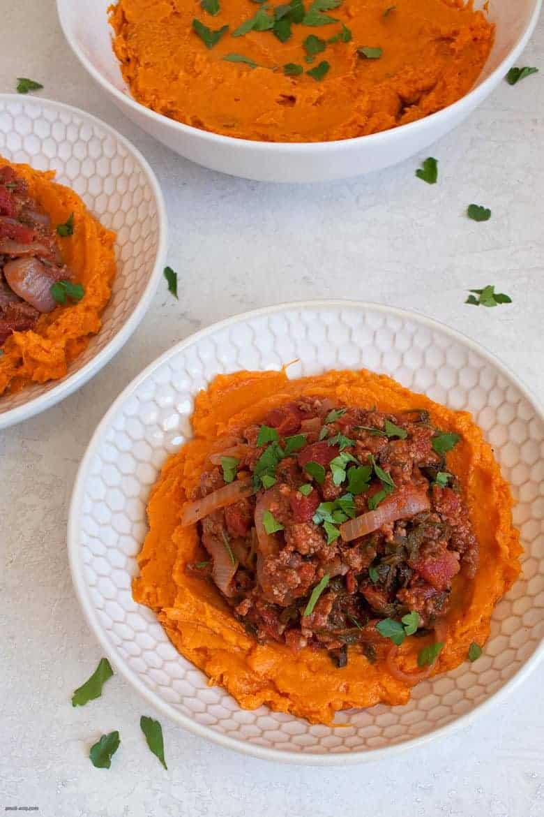 A comforting and easy to make weeknight dinner packed with ground beef, vegetables and mashed sweet potatoes. | Ground Beef, Arugula and Sweet Potato Mash Bowl (gluten free, dairy free) from small-eats.com